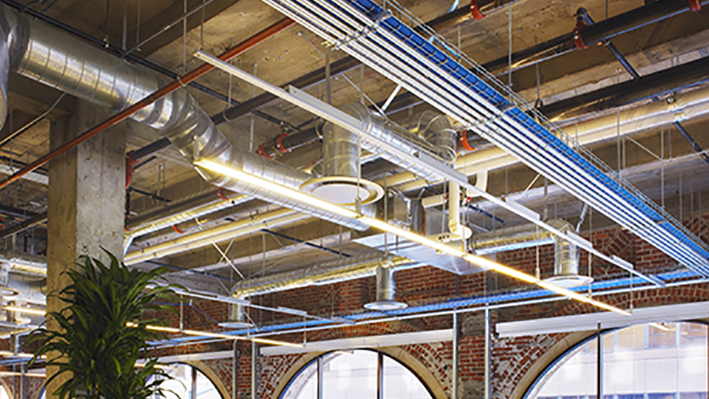 The full, unsilhouetted version of the AutoCAD MEP 2010 image.  Interior view of the Autodesk office on the second floor at One Market St., San Francisco, CA.  Shows exposed brick interior with MEP layout of ducts, pipes, lighting, fire protection and cable trays.